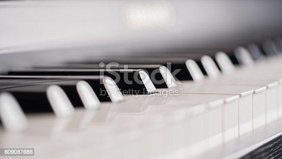Piano keys and sheet music.Piano keys and sheet music.