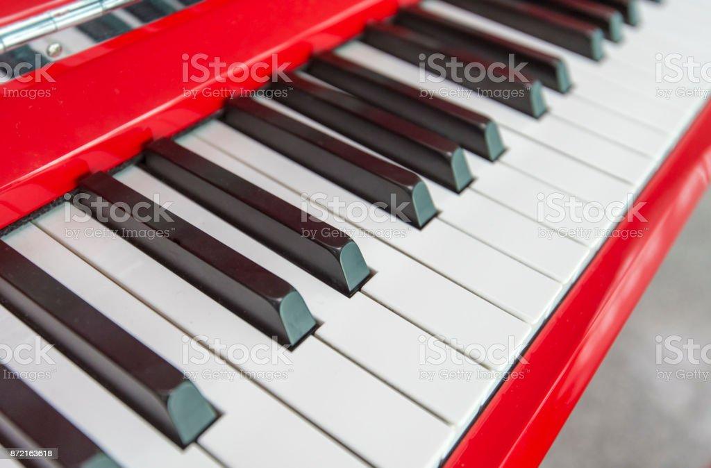 Piano keys, red Piano, close-up of piano keys