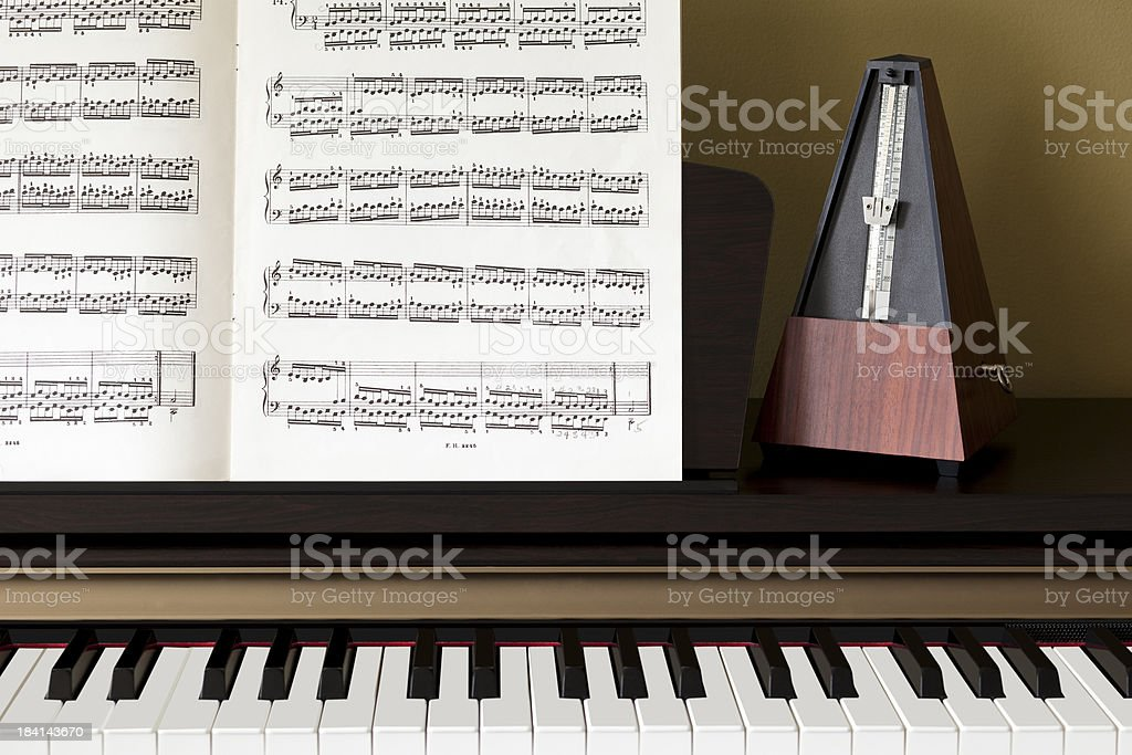 Piano Keys Sheet Music And A Metronome Stock Photo More Pictures
