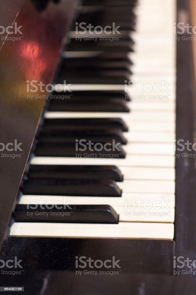 Piano keys side view with shallow depth of field . royalty-free stock photo