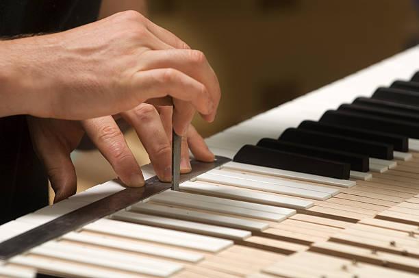 Piano maker files the keys