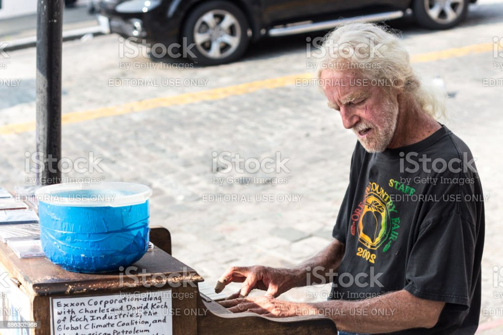 A piano man at Pike Martket, Seattle. stock photo
