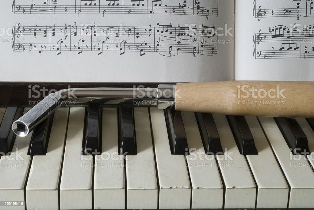 Piano, music and tuner stock photo