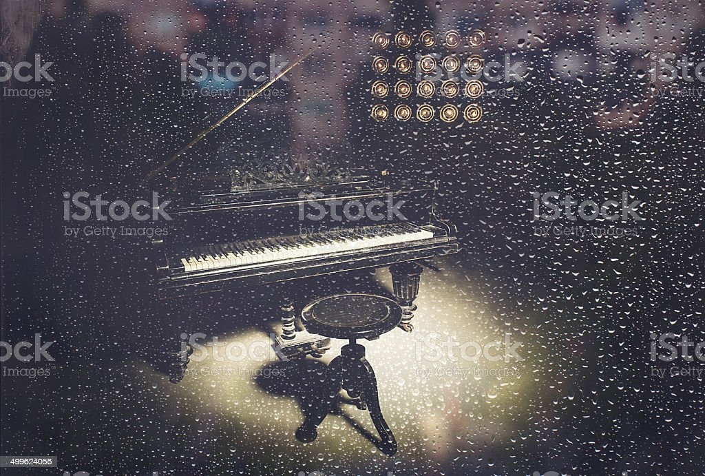 Piano music in the a rainy evening stock photo