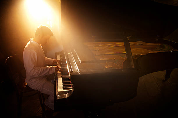 Piano Player file_thumbview_approve.php?size=1&id=19484914 pianist stock pictures, royalty-free photos & images