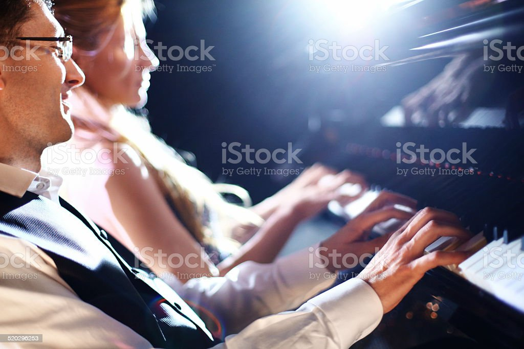 Piano players in a concert. stock photo