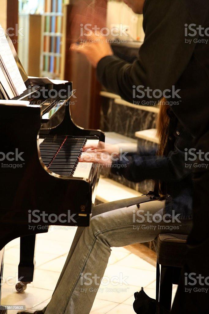 Piano playing royalty-free stock photo