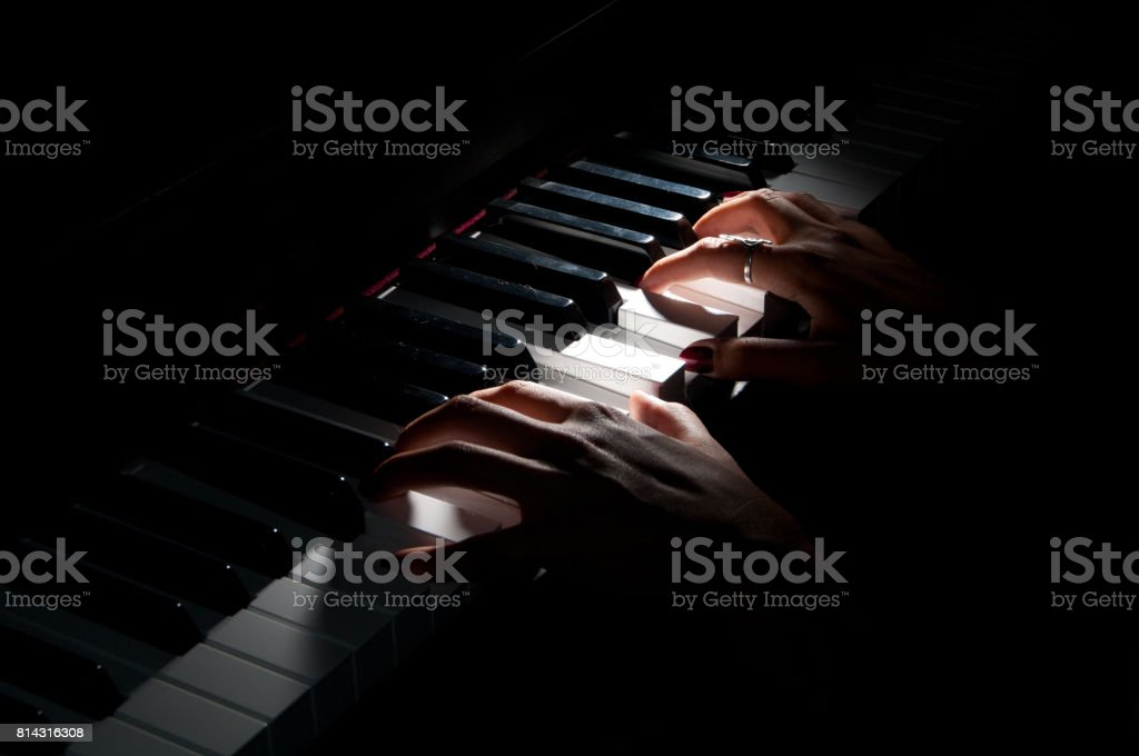 Piano playing stock photo