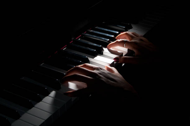 Piano playing Piano playing pianist stock pictures, royalty-free photos & images