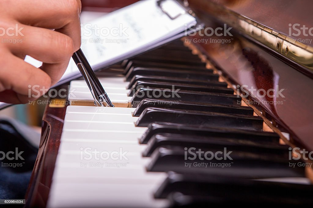 piano song on a clipboard and playing piano with ballpen stock photo