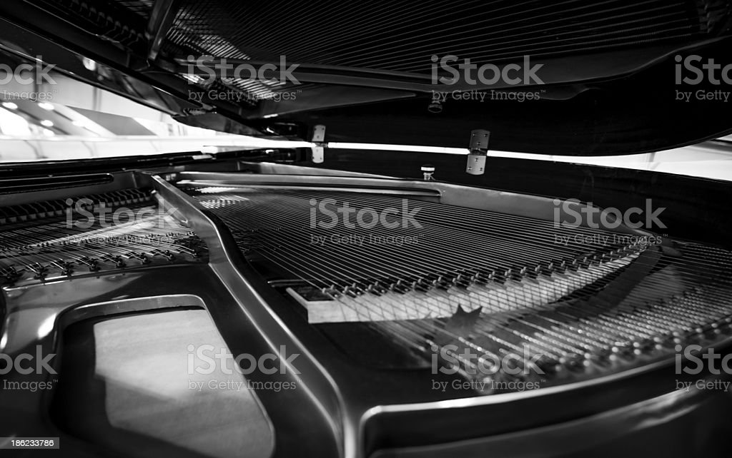 Piano strings and hammer stock photo
