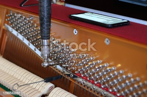 Acoustic piano tuning