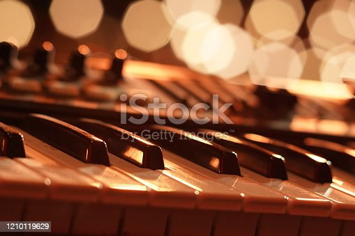 Entertainment piano keyboard with a backdrop of golden bokeh
