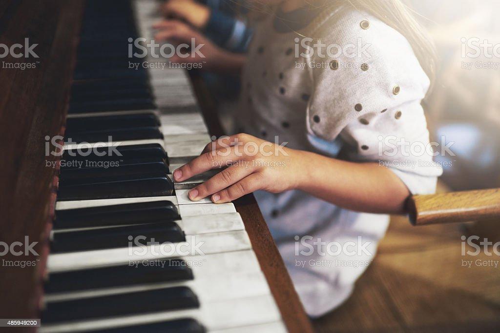 Pianos Sperr den Schlüssel zu Kindheit talent Lizenzfreies stock-foto
