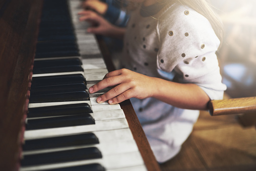 Cropped shot of a little girl playing the pianohttp://195.154.178.81/DATA/i_collage/pi/shoots/783959.jpg