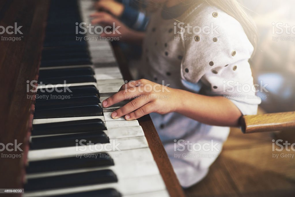 Pianos unlock the keys to childhood talent stock photo