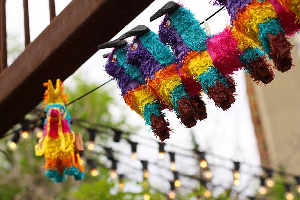 piñatas on display - cinco de mayo stock photos and pictures
