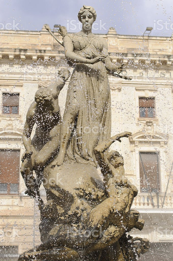 Piazza Archimede, Siracusa in Italy. The Artemis Fountain. royalty-free stock photo
