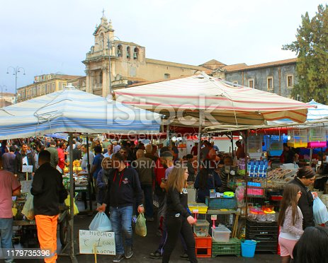 Catania, Italy - 2nd November, 2018: Unidentified people and vendors standing and walking in Piazza Carlo Alberto Sunday Market