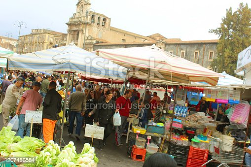 Catania, Italy - 2nd November, 2018: People shopping and selling goods in Piazza Carlo Alberto Sunday Market