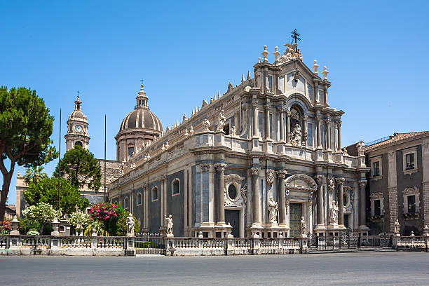 Piazza del Duomo and Cathedral of Santa Agatha in Catania Piazza del Duomo with the Elephant Statue and the Cathedral of Santa Agatha in Catania in Sicily, Italy catania stock pictures, royalty-free photos & images