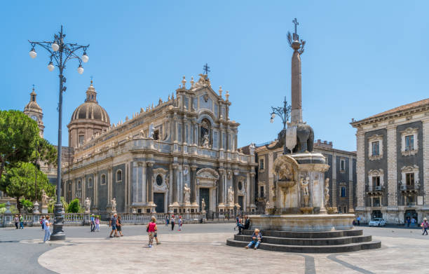 Piazza del Duomo in Catania on a summer morning, with Duomo of Saint Agatha and the Elephant Fountain. Sicily, southern Italy. July-02-2018 Piazza del Duomo in Catania on a summer morning, with Duomo of Saint Agatha and the Elephant Fountain. Sicily, southern Italy. July-02-2018 catania stock pictures, royalty-free photos & images