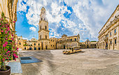 Lecce, Italy - August 13, 2018: Piazza del Duomo square and Virgin Mary Cathedral in Lecce, Puglia region, southern Italy
