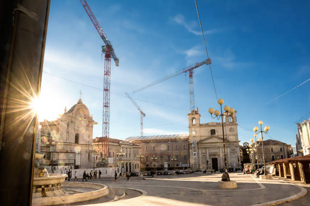 Piazza del Mercato dell'Aquila in reconstruction after the earthquake L'Aquila - Italy - October 14, 2017: Piazza del Mercato dell'Aquila in reconstruction after the earthquake mercato stock pictures, royalty-free photos & images