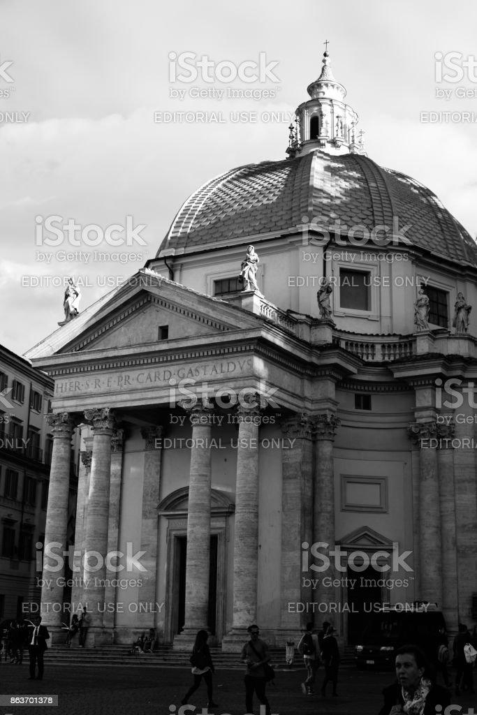 Piazza del Popolo is a town square in the historical center of Rome, Italy. Santa Maria dei Miracoli and Santa Maria di Montesanto are the two churches at Piazza del Popolo. stock photo