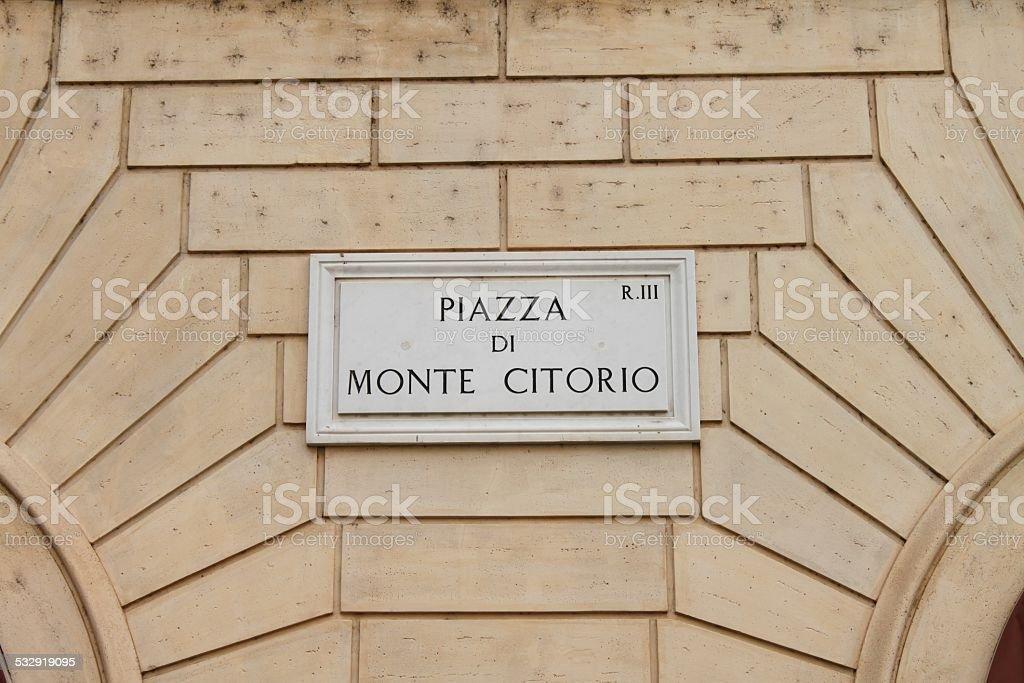 Piazza di Monte Citorio street plate stock photo