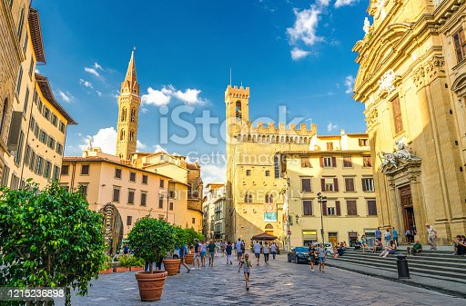 Florence, Italy, September 15, 2018: Piazza di San Firenze square with Chiesa San Filippo Neri, Badia Fiorentina Monastero catholic church and Bargello museum in historical centre of city, Tuscany