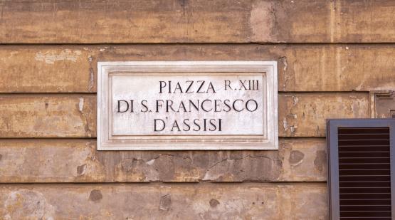 Piazza di san Francesco d'Assisi street name sign, Rome Italy