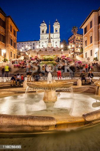 Rome, Italy, April 30, 2019: A group of tourists in Piazza di Spagna, famous town square with the Fontana della Barcaccia, fountain sculpted by Gian Lorenzo Bernini