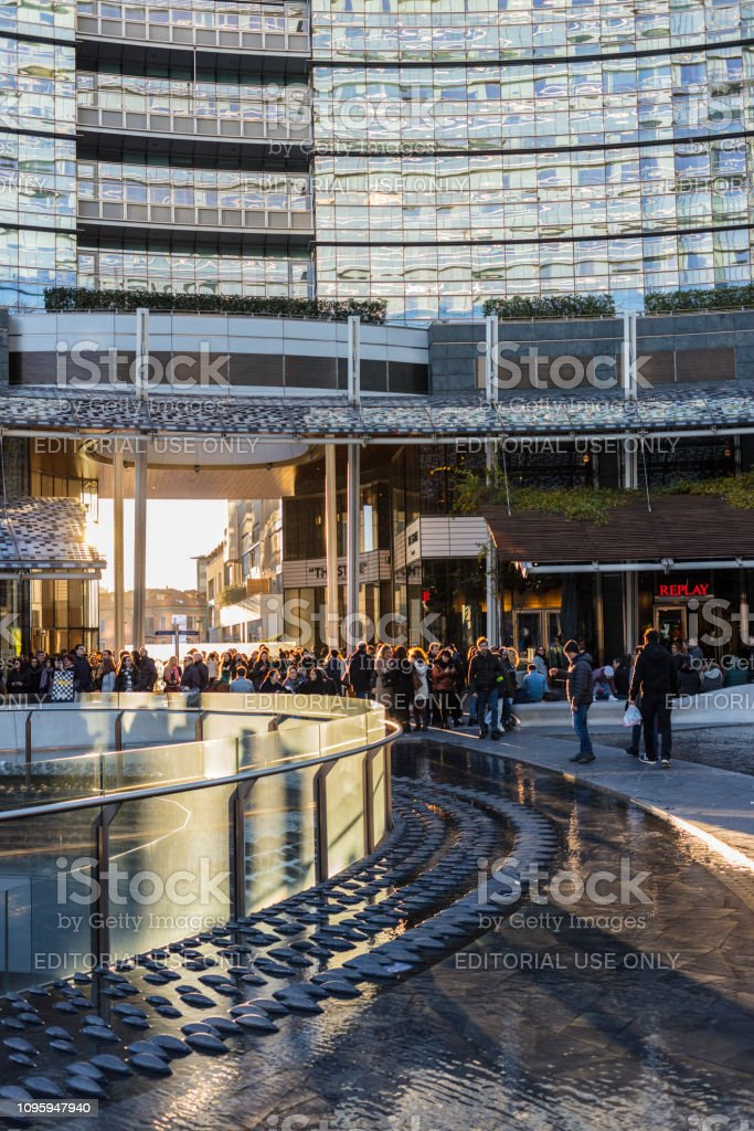 Piazza Gae Aulenti with people walking (Milan, Italy) stock photo