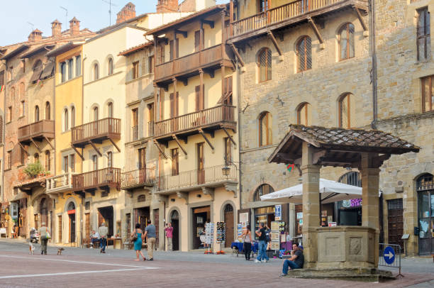 Piazza Grande - Arezzo Arezzo, Tuscany, Italy - September 24, 2011: Tourists in Piazza Grande, in front of medieval four storey houses piazza grande stock pictures, royalty-free photos & images