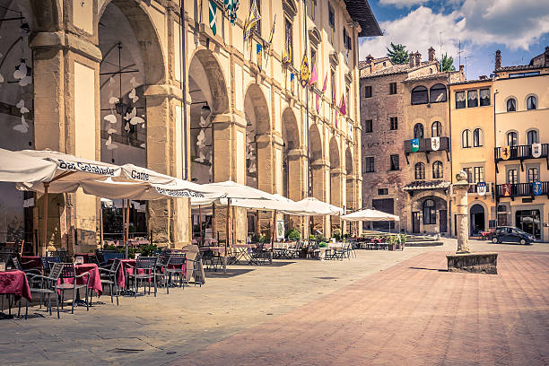 Piazza Grande in Arezzo city, Italy Arezzo, Italy - June 26, 2015: Piazza Grande the main square of tuscan Arezzo city, Italy arezzo stock pictures, royalty-free photos & images