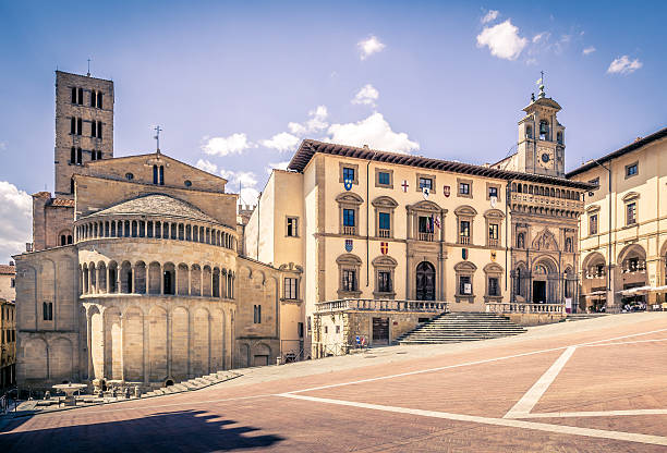 Piazza Grande in Arezzo, Italy Arezzo, Italy - June 26, 2015: Piazza Grande the main square of tuscan Arezzo city, Italy arezzo stock pictures, royalty-free photos & images