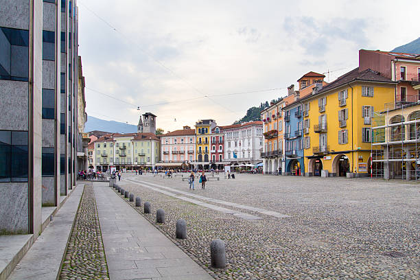 Piazza Grande, Locarno Locarno, Switzerland - September 27, 2013: Piazza Grande is the main square of Locarno. In the picture we see the old houses, vans and people walking around the square. Every year on the Piazza Grande take place Locarno Film Fesitival. piazza grande stock pictures, royalty-free photos & images