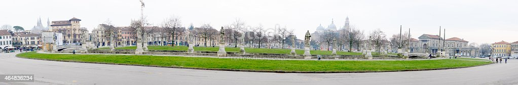Padua, Italy - January 30, 2015: Panoramic view of Piazza Prato della Valle, with Local market, the Basilica of St Giustina, the Basilica of St Anthony of Padua, local and tourists, in Padua, Veneto, Italy