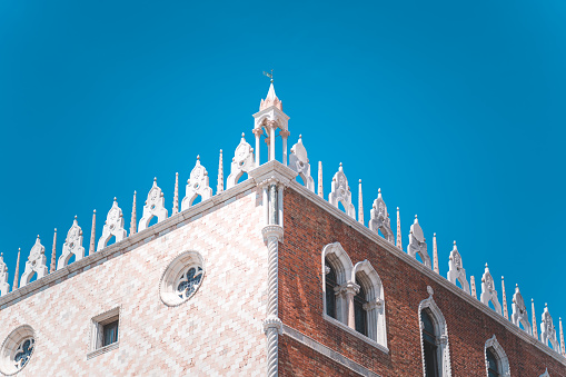 Piazza San Marco Saint Mark Square with Basilica di San Marco. Roof architecture details against blue sky in Venice,Italy. Tourist attraction, summer city trip