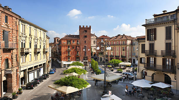 Piazza Statuto, Asti, Torre Guttuari on background, sunny day stock photo