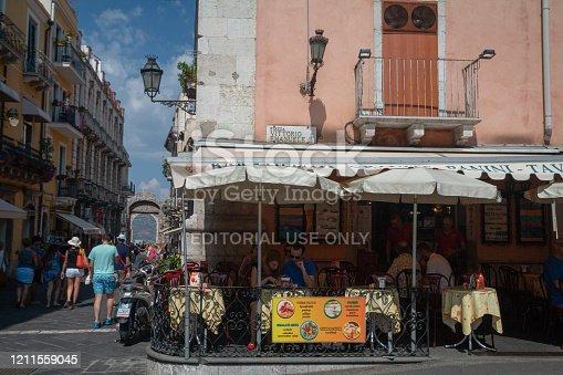 Piazza Vittorio Emanuele in Taormina, Sicily, with people dining al fresco