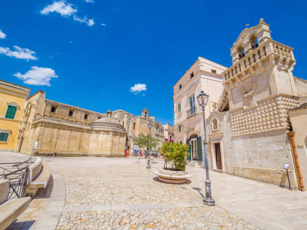 Piazza Vittorio Veneto, hypogeum square in the historic center, of Matera, UNESCO World Heritage Site, European Capital of Culture 2019 (wide) Piazza Vittorio Veneto, hypogeum square in the historic center, of Matera, UNESCO World Heritage Site, European Capital of Culture 2019 (wide) matera italy stock pictures, royalty-free photos & images