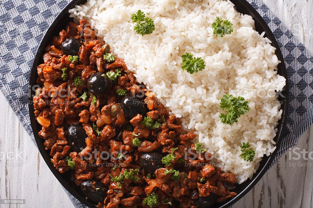 Picadillo a la habanera with rice close-up on the table stock photo