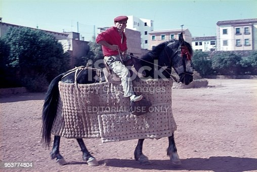 Malaga, Andalusia, Spain, 1975. A Picador trains his horse in the front of the bullfight arena.