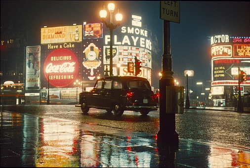 London, England, UK, 1962. The Piccadilly Circus at night and fog.