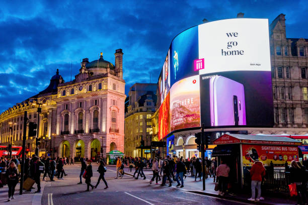 Piccadilly Circus at night This is an evening view of Piccadilly Circus, a famous shopping and travel destination in central London on March 26, 2018 in London central london stock pictures, royalty-free photos & images