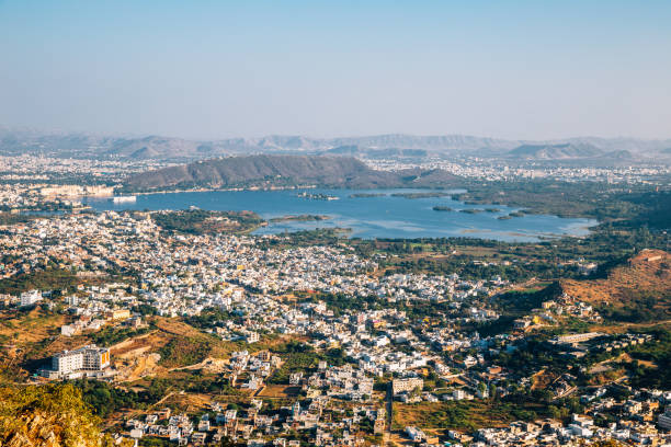 Pichola Lake and old town panoramic view from Monsoon Palace in Udaipur, India stock photo