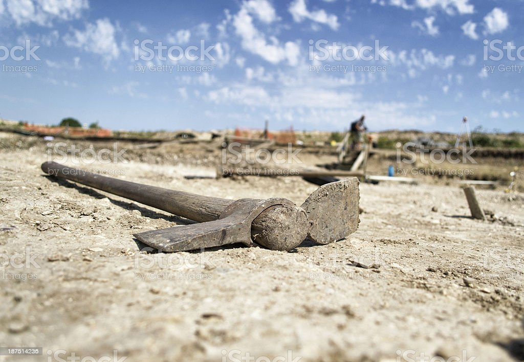 A pick axe used to remove soil lies at the roman archaeological site...