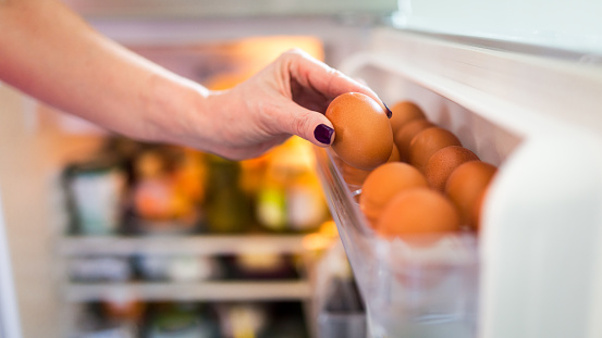 istock Pick eggs from the refrigerator 637261122